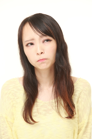 51880714 - young japanese woman worries about something