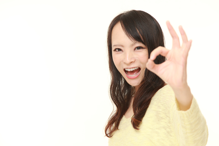 51881011 - japanese woman showing perfect sign