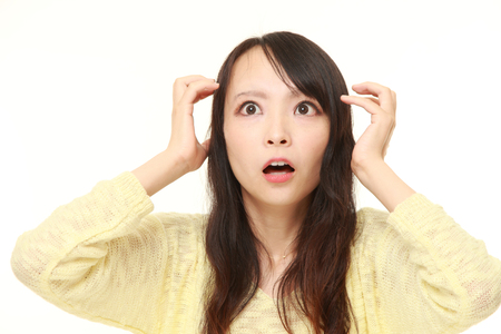 62835430 - young japanese woman shocked