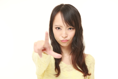 51880698 - young japanese woman scolding