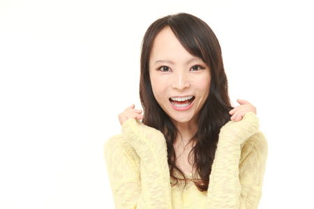 51880995 - young japanese woman pleased