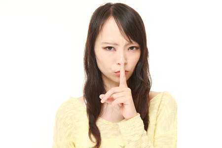 51881027 - young japanese woman whith silence gestures