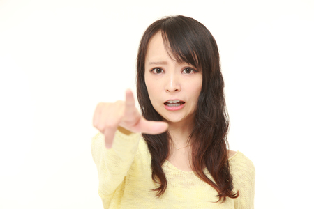 62835050 - young japanese woman shocked